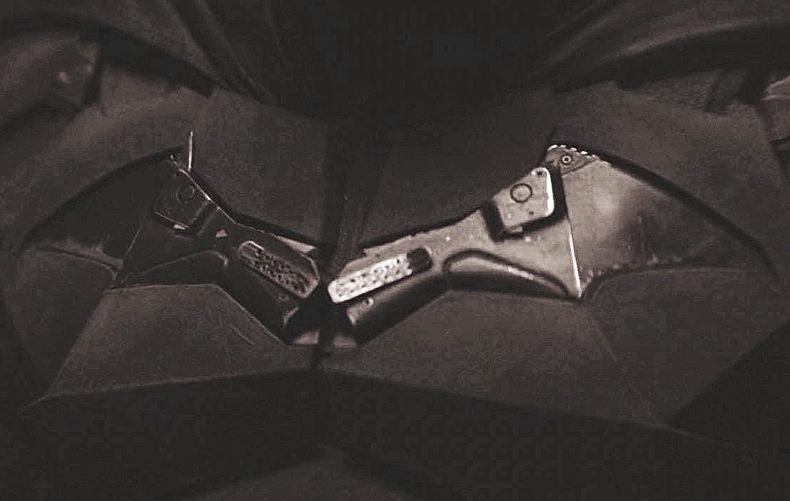Batman Robert Pattinson Batsuit symbol gun