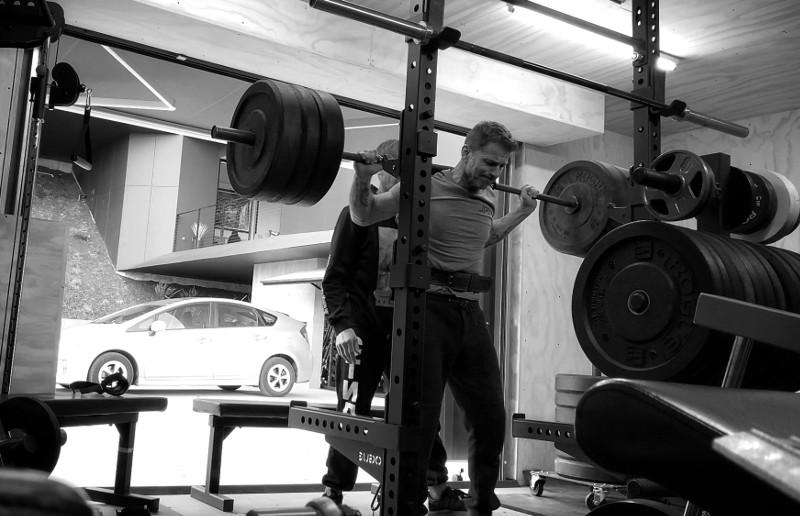 Zack Snyder squatting