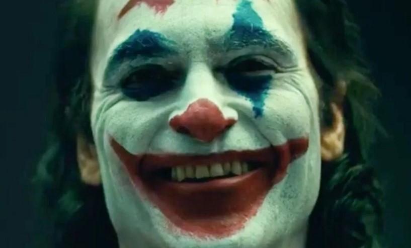 Christian Bale reacts to Joaquin Phoenix as Joker